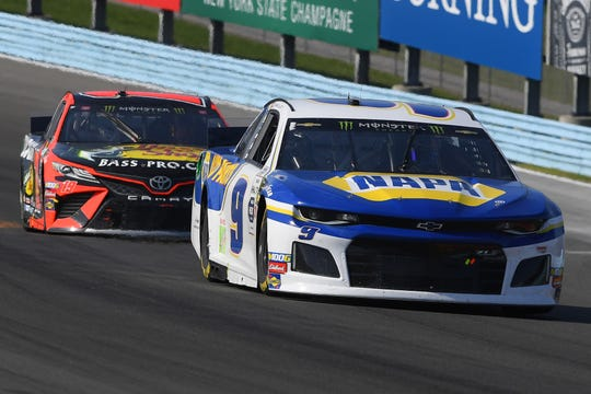 Monster Energy NASCAR Cup Series driver Chase Elliott (9) leads driver Martin Truex Jr. (19) during the Go Bowling at The Glen at Watkins Glen International on Aug. 4, 2019.