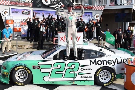Aug 3, 2019; Watkins Glen, NY, USA; NASCAR Xfinity Series driver Austin Cindric (22) celebrates in victory lane following the Zippo 200 at The Glen at Watkins Glen International. Mandatory Credit: Rich Barnes-USA TODAY Sports