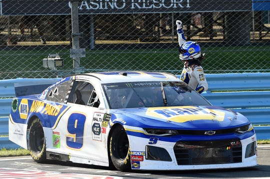 Monster Energy NASCAR Cup Series driver Chase Elliott gestures to the crowd following his victory in the Go Bowling at The Glen at Watkins Glen International on Aug. 4, 2019.