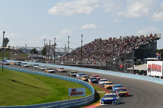 Monster Energy NASCAR Cup Series driver Chase Elliott (9) leads the field on a re-start during the Go Bowling at The Glen at Watkins Glen International on Aug. 4, 2019.