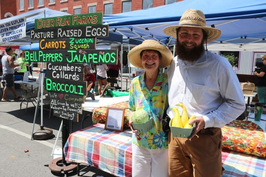 Andrew Winters and his grandmother, of Deer Run Farms in Fremont, spent their Saturday morning downtown offering fresh locally-grown produce at the farmer's market.