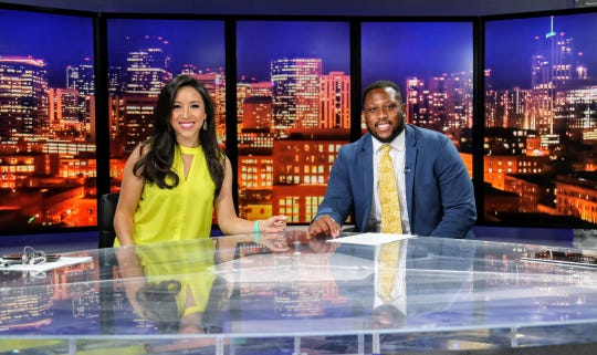 CSU football player Ellison Hubbard, right, on set at 9News in Denver this summer as part of the student-athlete summer career experience program.