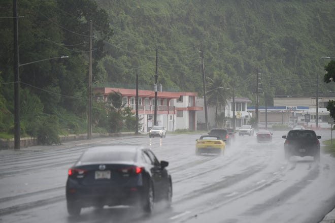 Motorists pass through wet roads during rainy weather in east Hagåtna, Aug. 4, 2019.