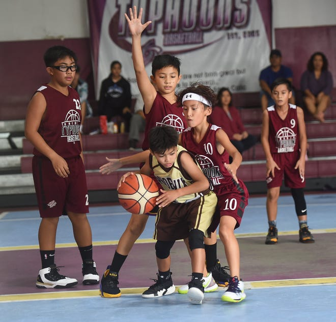The Tamuning Typhoons bested MCS Phoenix 48-32 in the 2019 Annual Summer Jam Tournament 12U Coed Division playoffs at the Tamuning Gym on Aug. 4, 2019. Tristan Hahn and Michael Bork lead the Typhoons in scoring with 10 points a piece.