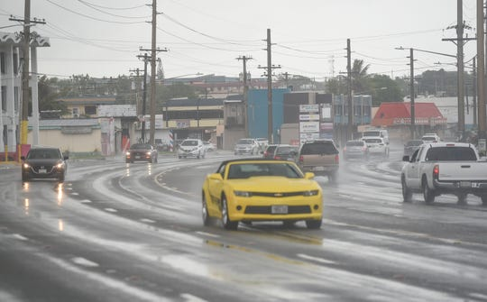 Motorists pass through wet roads during rainy weather in Tamuning, Aug. 4, 2019.
