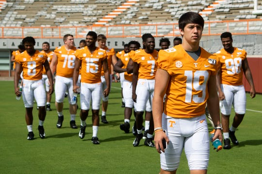 Tennessee quarterback Steven Orr (19) arrives for team photos Sunday at Neyland Stadium.