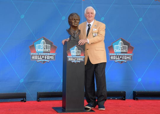 Gil Brandt poses with his bust during the Pro Football Hall of Fame Enshrinement in Canton, Ohio Saturday night.