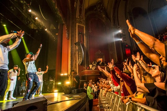 Hip-hop legends Wu-Tang Clan bond with the crowd at the Riverside Theater Saturday night. The seminal group's stop in Milwaukee was part of a 25th anniversary tour.