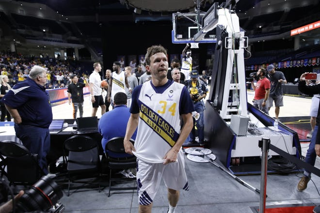 Travis Diener walks off the Wintrust Arena court after nailing the winning three-pointer for the Golden Eagles in The Basketball Tournament.