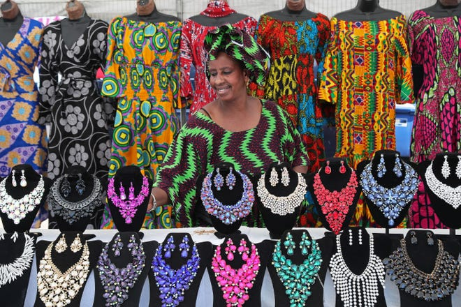 Touba Fall of Touba Africa Art sets out items to sell during a previous Bronzeville Week Celebration. This year's celebration of the historically African American neighborhood will take place Aug. 7 through Aug. 14.