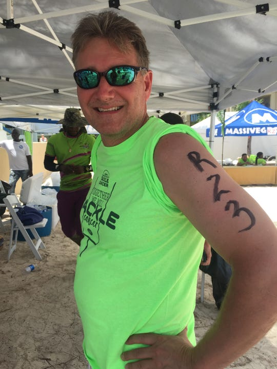 """Allan Ripple. """"I got that shirt at the Lombardi Cancer Walk which was my first after treatment. On the back it has """"Survivor"""" across the shoulders and then the Lombardi quote, """"Its not whether you get knocked down, it's whether you get up."""""""