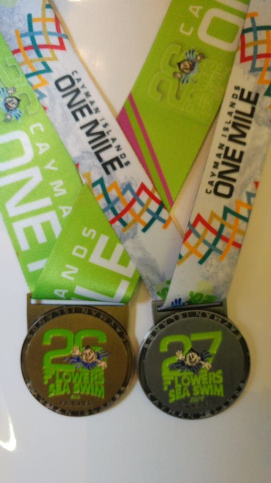 Allan Ripple's medals from completing two Flowers Sea Swim races. The one-mile swim raises money for cancer research.