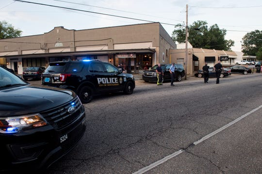 Police investigate a shooting on Woodley Road in Montgomery, Ala., on Saturday, Aug. 3, 2019. Police belief the shots came from a car, no one was injured.