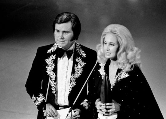 "Presenters George Jones, left, and Tammy Wynette are getting ready to announce the Album of the Year winner at the 8th annual CMA Awards show Oct. 14, 1974. One of their biggest hits together is ""Golden Ring."""
