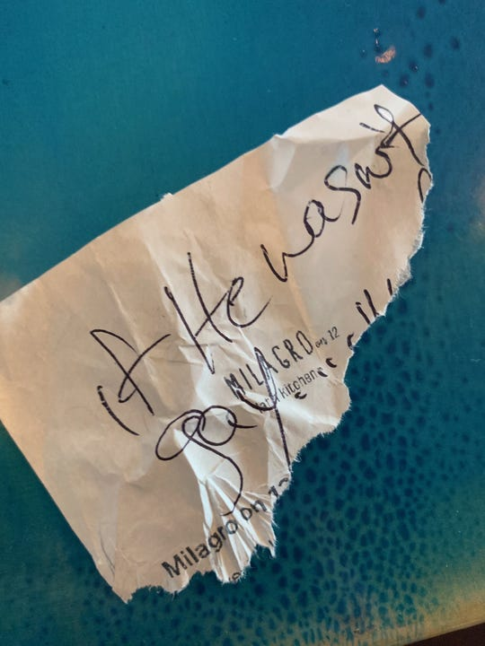 "Part of the torn-up receipt from Milagro On 12 Kitchen in St. Augustine, with ""if he wasn't gay"" written on it."
