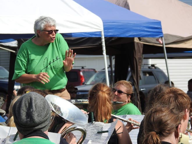 Licking County 4-H band director Jane Copenhefer, since retired, is seen leading current members and alumni in a concert last year on the grounds of the demolished North Elementary in Newark.