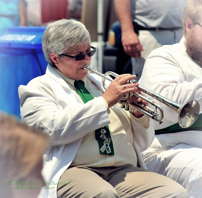Now-retired Licking County 4-H band director Jane Copenhefer plays the trumpet during a past concert.