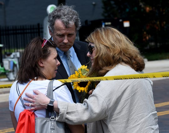 Sonya Lewis asks senator Sherrod Brown and his wife Connie Schultz if they can take some flowers to the scene of Sunday's mass shooting in Dayton's Oregon District. Lewis had considered visiting Ned Peppers Bar the night of the shooting.