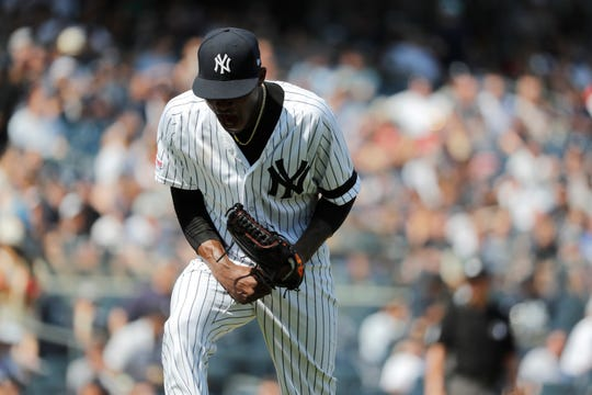 New York Yankees starting pitcher Domingo German reacts after three straight strikeouts against the Boston Red Sox in the sixth inning of a baseball game, Saturday, Aug. 3, 2019, in New York.