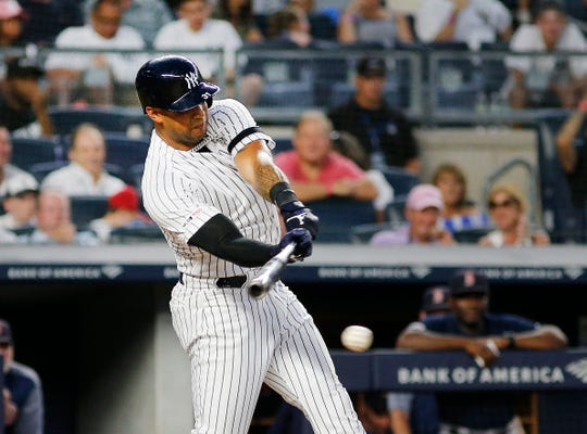 Aug 3, 2019; Bronx, NY, USA; New York Yankees center fielder Aaron Hicks (31) singles against the Boston Red Sox during the third inning of game two of a doubleheader at Yankee Stadium.