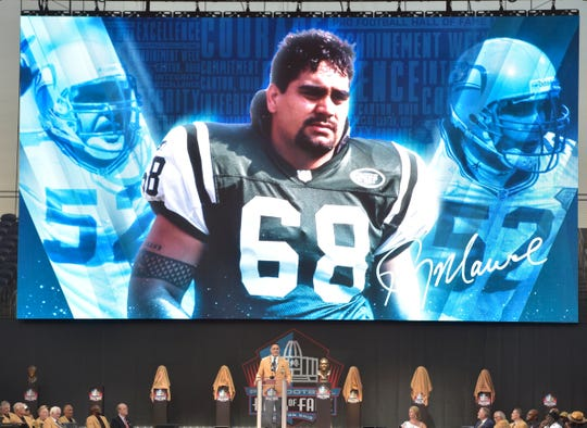 Former NFL player Kevin Mawae speaks during the induction ceremony at the Pro Football Hall of Fame, Saturday, Aug. 3, 2019, in Canton, Ohio.