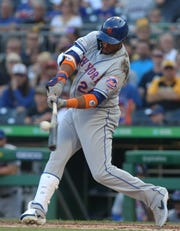 Aug 3, 2019; Pittsburgh, PA, USA; New York Mets second baseman Robinson Cano (24) singles against the Pittsburgh Pirates during the first inning at PNC Park.