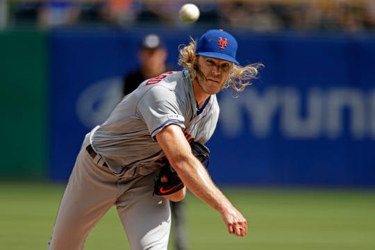 New York Mets starting pitcher Noah Syndergaard delivers during the sixth inning of a baseball game against the Pittsburgh Pirates in Pittsburgh, Sunday, Aug. 4, 2019.