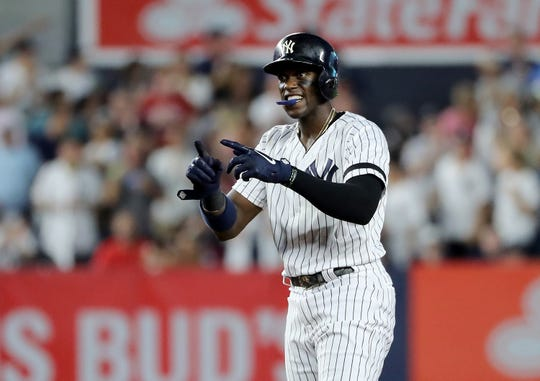 Cameron Maybin #38 of the New York Yankees celebrates his 2 RBI double in the third inning against the Boston Red Sox during game two of a double header at Yankee Stadium on August 03, 2019 in New York City.