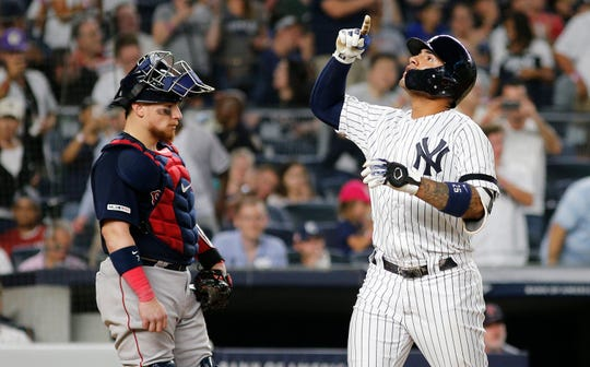 Aug 3, 2019; Bronx, NY, USA; New York Yankees shortstop Gleyber Torres (25) reacts after hitting a solo home run against the Boston Red Sox during the fifth inning of game two of a doubleheader at Yankee Stadium.