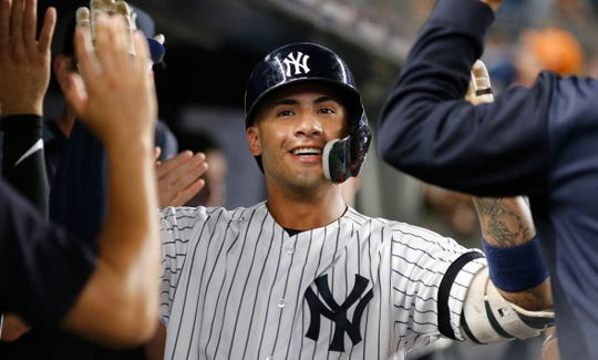 Aug 3, 2019; Bronx, NY, USA; New York Yankees shortstop Gleyber Torres (25) is congratulated after hitting a solo home run against the Boston Red Sox during the fifth inning of game two of a doubleheader at Yankee Stadium.