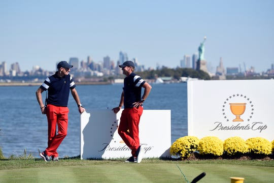 United States team captains Jim Furyk, left, and Steve Stricker wait at hole 10 during the Presidents Cup. The United States defeated the International team 19-11 at the Liberty National Golf Club in Jersey City, NJ on Sunday, October 1, 2017.