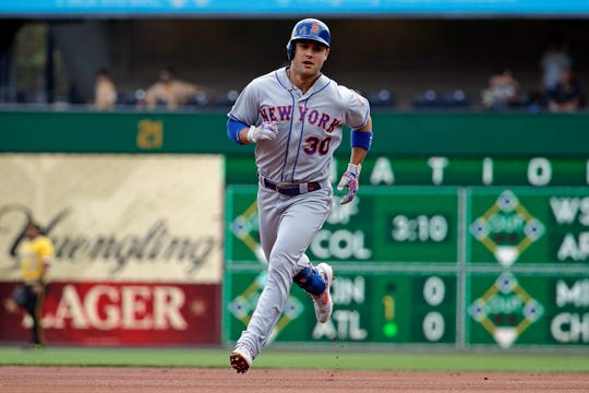 New York Mets' Michael Conforto rounds second after hitting a home run off Pittsburgh Pirates starting pitcher Joe Musgrove during the first inning of a baseball game in Pittsburgh, Sunday, Aug. 4, 2019.