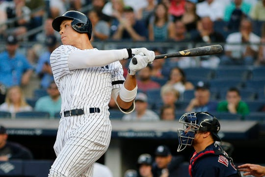 Aug 3, 2019; Bronx, NY, USA; New York Yankees designated hitter Aaron Judge (99) singles against the Boston Red Sox during the first inning of game two of a doubleheader at Yankee Stadium.
