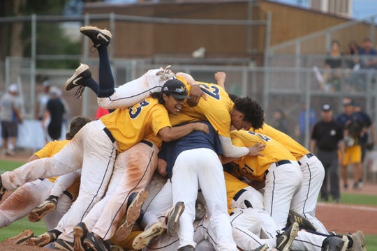 The Midland Redskins celebrate winning their 16th Connie Mack World Series title in program history on Saturday at Ricketts Park in Farmington.