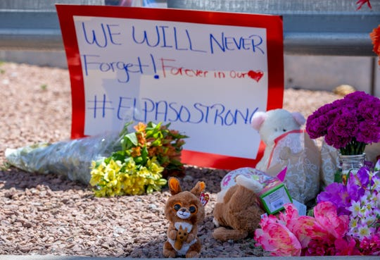Flowers and toys adorn a makeshift memorial for the victims of Saturday mass shooting at a shopping complex in El Paso, Texas, Sunday, Aug. 4, 2019. (AP Photo/Andres Leighton)