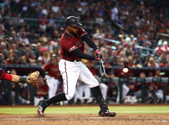 Aug 4, 2019: Arizona Diamondbacks outfielder Adam Jones hits a two run single in the seventh inning against the Washington Nationals at Chase Field.