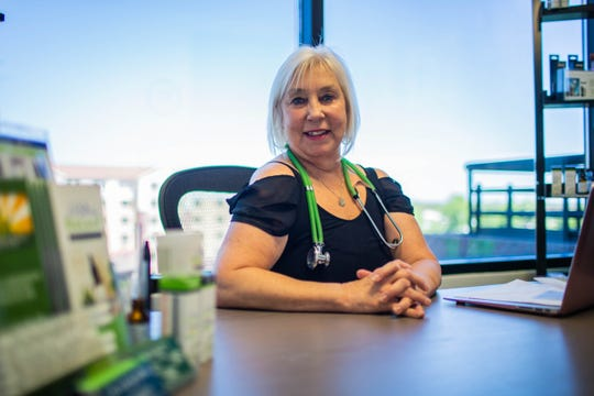 Dr. Elaine Burns, nicknamed the 'pot doctor', poses for a portrait in her Scottsdale office on July 9, 2019.