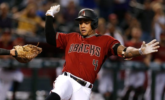 Arizona Diamondbacks' Ketel Marte crosses home plate after hitting an inside-the-park home run against the Washington Nationals in the third inning during a baseball game, Sunday, Aug. 4, 2019, in Phoenix.