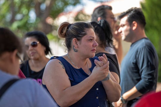Relatives of victims of the Walmart mass shooting wait for information from authorities at the reunification center in El Paso, Texas, Sunday, Aug. 4, 2019. (AP Photo/Andres Leighton)