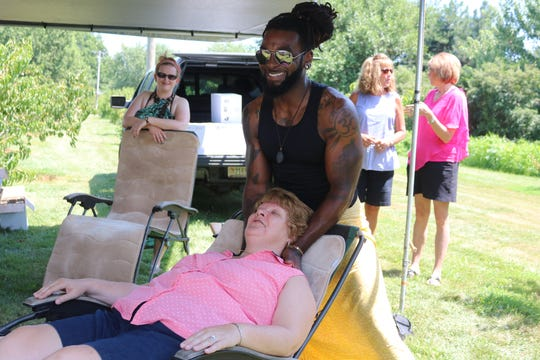 "Thanks to Santell Nelson and Wendy Faber, who operate ""Breathe In Live Out,"" a massage studio and so much more based in Avon, there was an opportunity for a strong sense of relaxation as well, both physically and spiritually, at the 2019 Catawba Peach & Wine Festival."