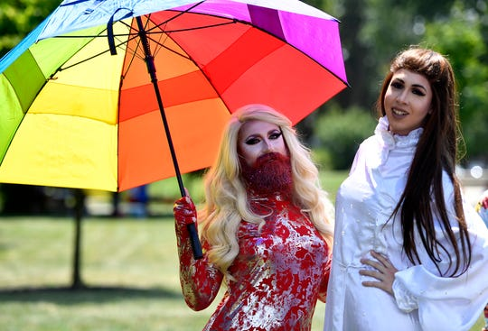 Drag Queens Veronica V-Ron Lush, left of Baltimore, and Sarabesque, of York, prepare to perform during Equality Fest 2019 at Penn Park, Sunday, August 4, 2019. 