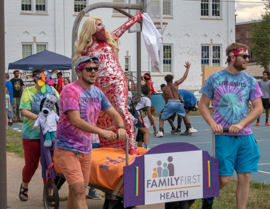 Drag show artist Veronica Lush surfs a Family First Health bed during an impromptu 'drag race' against fellow artist Sarabesque, each raising funds for Bell Socialization Services. Bells Big Bed Race was held alongside Equality Fest 2019; What We Learned at Stonewall at Penn Park Sunday.