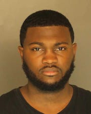 Zamir Tyler-Johnson, arrested for aggravated assault, firearms not to be carried without a license, propel missile into occupied vehicles, simple assault and recklessly endangering another person.