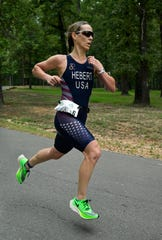 Choudrant's Linzie Hebert became the first four-time winner of the River Cities Triathlon.
