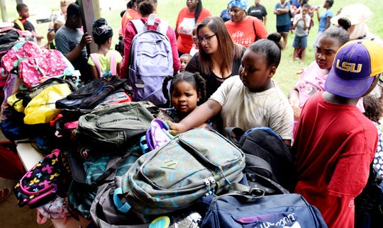 Roy's Kids, a non-profit charitable organization, gave hundreds of backpacks filled with school supplies to kids Saturday morning at Swepco Park.