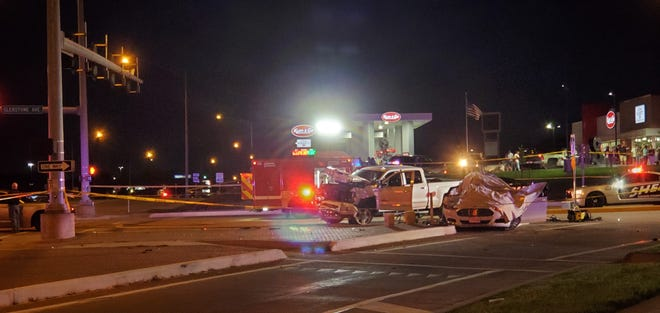 Officers work at the scene of a multiple-fatality accident at Kearney Street and Glenstone Avenue on Saturday, Aug. 3, 2019, in Springfield, Mo.