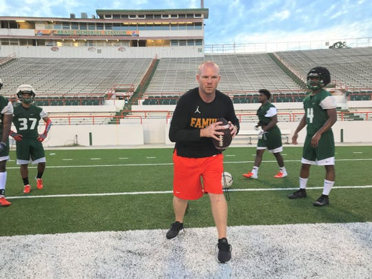 Dan Lemke leads a  workout drill with nickelbacks during the first day of practice at FAMU on Friday, Aug. 2, 2019.