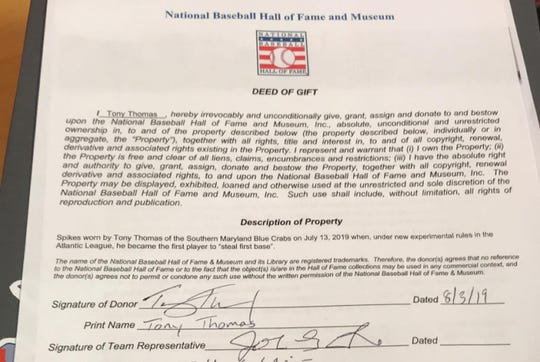 Tony Thomas' signed paperwork to gift his baseball cleats to the National Baseball Hall of Fame Museum.