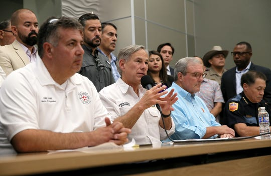 Texas Governor Greg Abbott speaks at a press conference Saturday about a mass shooting at a Walmart in east El Paso.