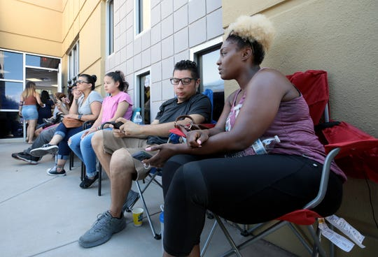 Blood donors waited hours to donate Sunday, Aug. 4, 2019, in East El Paso, Texas. With a huge response Saturday after the mass shooting at an East-Central El Paso Walmart, most were asked to return Sunday.